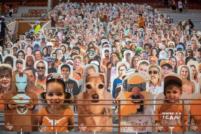 The new normal: Cutout images of Texas fans filled lower-deck seats at Royal-Memorial Stadium for the Longhorns' 2020 football season opener against UTEP. COVID-19 protocols called for stadium capacity to be slashed below 25%.