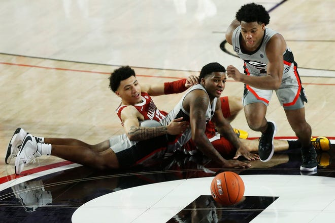 Georgia's Sahvir Wheeler (2) goes after the ball while Georgia's K.D. Johnson (0) and Alabama guard Jahvon Quinerly (13) look on during a basketball game between Alabama and Georgia in Athens, Ga., on Saturday, March 6, 2021. Alabama won 89-79. (Photo/Joshua L. Jones, Athens Banner-Herald)