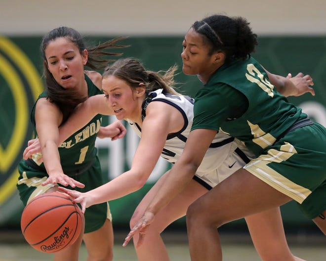 Hoban guard Karli Anker (center) battles for a loose ball between GlenOak seniors Meya Metz, (left) and Aniyah Hall during the second half of Friday's Division I regional championship game.