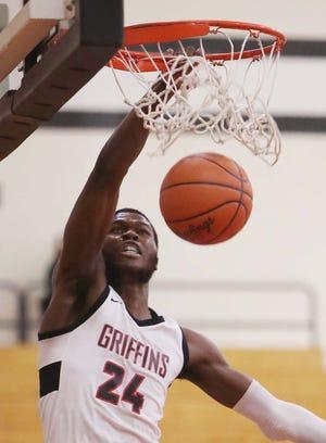 Buchtel junior Chris Livingston is a member of a star-studded list of area basketball players on the Beacon Journal All-Star team. [Karen Schiely/Beacon Journal]