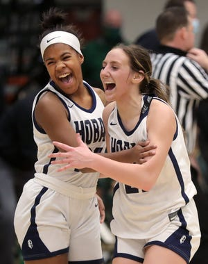 Hoban guard Karli Anker, right, celebrates with Mayana Pooler after defeating the GlenOak Golden Eagles, 59-46, in the Division I regional championship, Friday, March 5, 2021, in Medina, Ohio. [Jeff Lange/Beacon Journal]