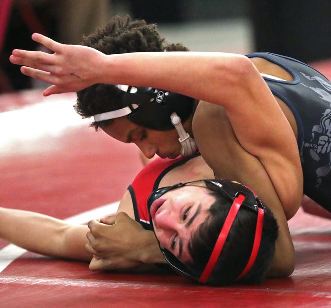 Copley's Marlon Yarbrough works over Canfield's Chris Thomas during their 113-pound match in the Division II district wrestling tournament Friday. [Jeff Lange/Beacon Journal]