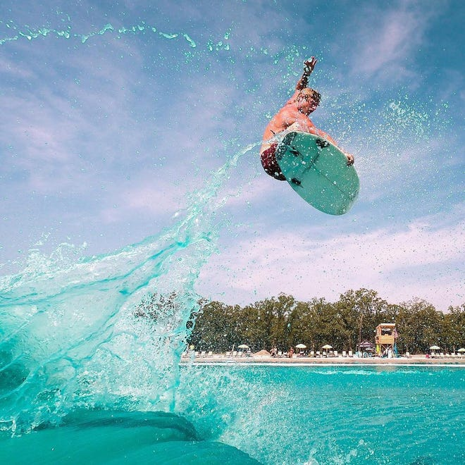 Surfer Cheyne Magnusson is projected high above BSR Cable Park in Waco, Texas, in 2019. A similar American Wave Machines Inc. pool is being planned for New Smyrna Beach in 2022.
