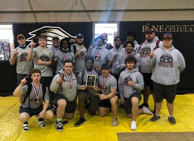 The Ardmore High School powerlifting team poses for a photo after winning a Class 5A Regional. The Tigers include Jackson Arthur, Matthew Sheehy, Trayven Newberry, Birch Wood, Kolby Lamb, Trae Coley, Reese Mathis, Riley Cox, Coach Blankenship, Joseph Martin, Parker Blankenship, JaQuan Pickens, Quentin Sheppard, Bryce Allen, Ricky Smith, Eric Fields and coach Larry Coley.
