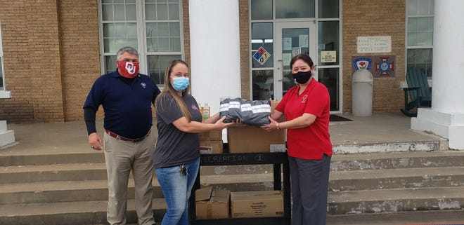 Ardmore Elks Lodge members make a donation of toiletries and socks to the Ardmore Veterans Center on Friday. The supplies were paid for with a grant received from the National Elks. The Ardmore chapter split these funds with a portion going to the Food and Resource Center of South Central Oklahoma and a portion to the Ardmore Veterans Center. From left to right: Ardmore Elks Lodge Exalted Ruler Kerry McGill, Ardmore Veterans Center Recreation Director Keri Honea, and Ardmore Elks Esquire Jody Westervelt.