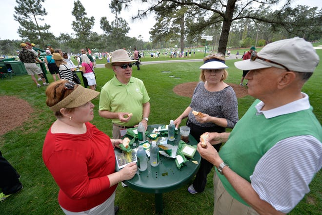 Norine Condon (from left), Pete Condon, Judy Allen and Jim Allen enjoy pimento cheese sandwiches during the first practice round at the 2015 Masters Tournament.