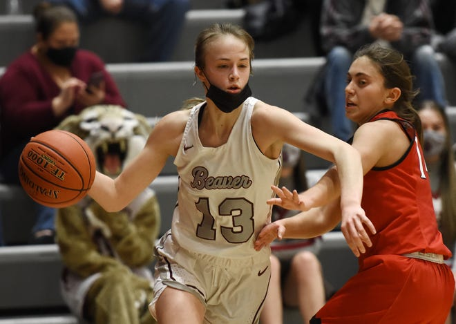 Beaver's Maddi Weiland drives to the hoop around Elizabeth Forward's Anna Resnik during Friday night's WPIAL class 4A playoff game at Beaver Area High School.