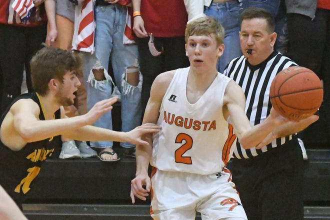 Oriole senior Brendan Parker (#2) looks to pass during the second half of Augusta's 59-51 Sub-State championship victory over Andale on Thursday.