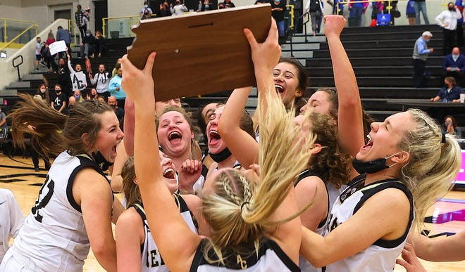 The Andover Central Jaguars celebrate winning the sub-state final over Kapaun Mt. Carmel on Friday, March 5 at Andover Central High School. It is back-to-back sub-state titles for Central.