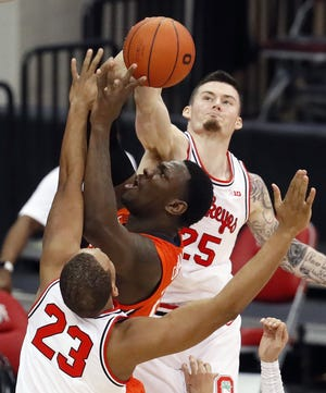 Ohio State Buckeyes forward Kyle Young (25) blocks Illinois Fighting Illini center Kofi Cockburn (21) during the first half of their game at Value City Arena in Columbus, Ohio on March 6, 2021.