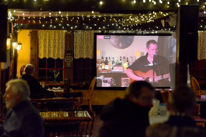 Sean Brennan performs virtually at O'Shea's Olde Inne in West Dennis. The answer to keeping live Irish music there has been a 100-foot screen and a live stream.