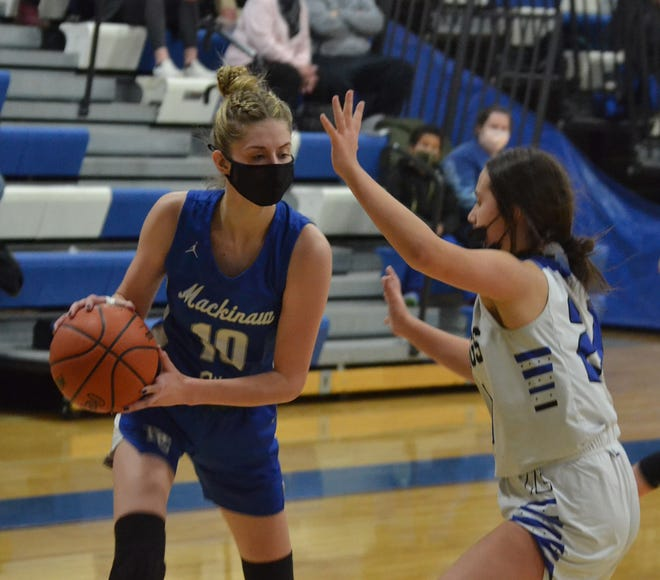 Sophomore Madison Smith (left) finished with 24 points, six rebounds, seven steals and four assists for the Mackinaw City girls in a victory at Wolverine on Friday.