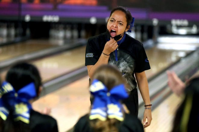 Addison Watson reacts to her Gahanna teammates after bowling a strike during the Lions' state championship win in the Division I state tournament Friday at Wayne Webb's Columbus Bowl.