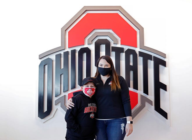 Ashley and Bentley Kreher traveled from Illinois so that Bentley could see his favorite player, Ohio State forward E.J. Liddell, play against No. 4 Illinois on Saturday at Value City Arena.