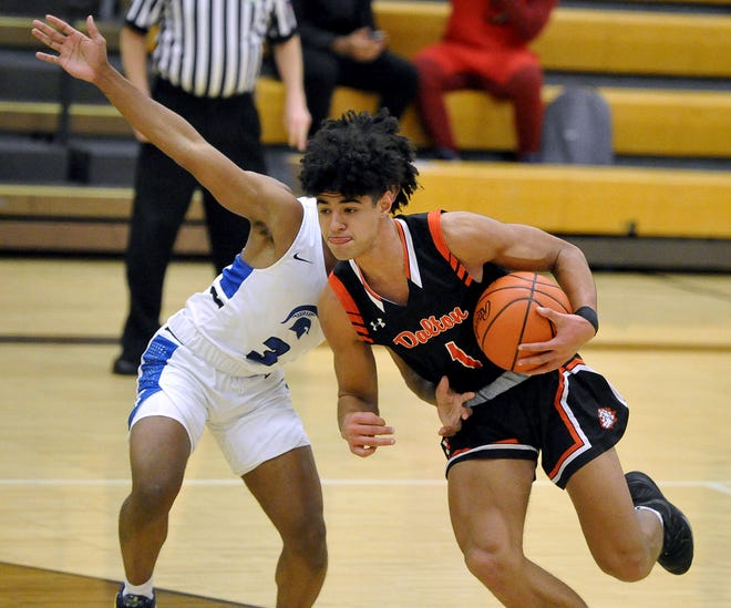 Dalton's Jalen Wenger drives on Richmond Heights' Lorenzo Nettles Jr. at the top of the key.