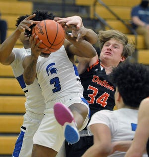 Richmond Heights' Lorenzo Nettles Jr. gets position and the rebound over Dalton Liam Riggenbach.
