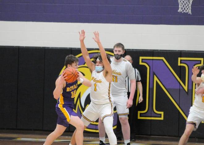 Blissfield's Gavin Ganun (12) looks to pass against the defense of Onsted's Lincoln Lipinski (1) and Ayden Davis (51) during Friday night's Lenawee County Athletic Association game in Onsted.