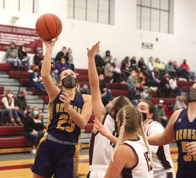Bronson's Addison Harris (25) throws up a baby hook from the block for two points versus Union City Friday night