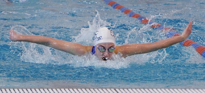 McDowell High School senior Jordan Nuzback wins the 100-yard butterfly during the District 10 Class 3A championships at the Hallman Aquatics Center on Saturday in Erie.