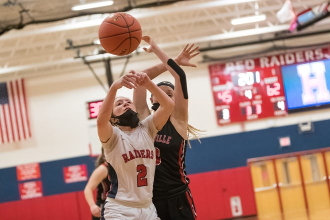Hornell's Jaden Sciotti fights through contact on her way to the rim during the fourth quarter of Friday's game against Dansville.
