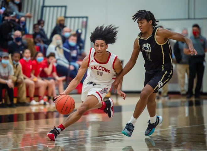 Van Horn senior guard Jaden Monday (11) drives the ball down court against William Chrisman's Anthony Watkins in Friday's Class 5 District 14 championship game. Monday scored 25 points to help lead the Falcons to a 61-52 win over the Bears and their first district title since 1995.