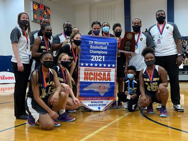 The Shelby girls basketball team celebrates after claiming the 2021 2A girls basketball championship on Saturday.