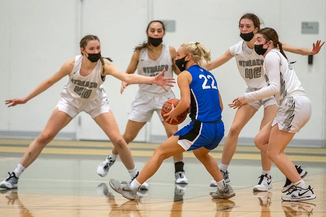 Galesburg defenders, from left, Abby Davidson, Kadynce Lydic, Audree Peck and Lauren Livingston surround Quincy's Bre Sapp during the Silver Streaks' 45-25 WB6 Conference loss to the Blue Devils on Friday, at the GHS field house.
