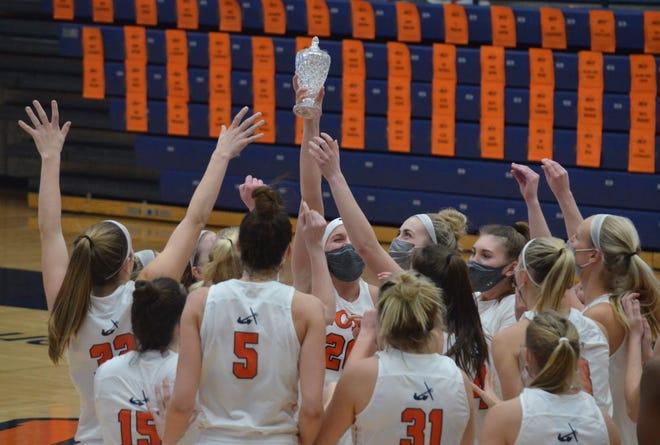 The Hope College women's basketball team celebrates winning the MIAA championship on Saturday at DeVos Fieldhouse.