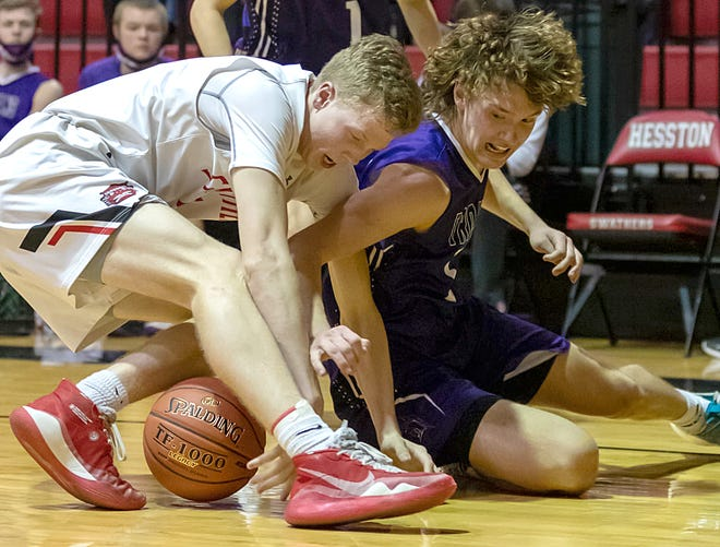 Hesston's Brayden Schilling, left, and Southeast of Saline's Jaxson Gebhardt  battle for a loose ball during their Class 3A sub-state semifinal game Friday night in Hesston.