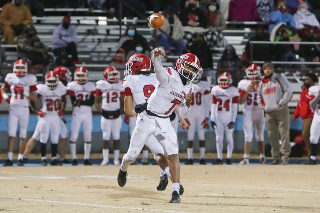 Jacksonville's Josh Benton throws a pass in the Cardinals' 32-27 win at East Duplin on Friday night.