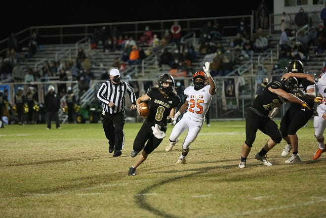 Croatan's Dustin Hayden finds running room in the Cougars' 24-21 win over Southwest on Friday night. [John Althouse / The Daily News]