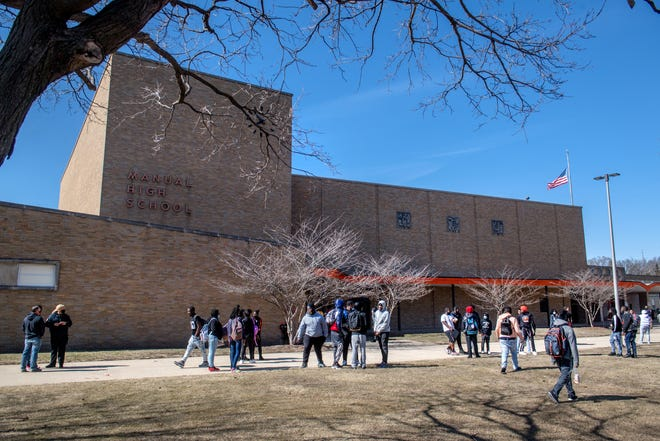 Students mill around in front of Manual High School as school lets out for the weekend on a recent Friday afternoon in South Peoria.