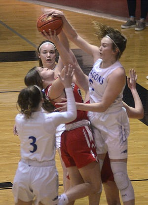 Halstead senior Karenna Gerber tries to block a shot during play Saturday against Hesston. Gerber scored 14 points in a 40-36 Halstead win.