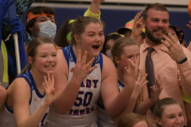 The Scotland County girls basketball team holds up four fingers to celebrate its quarterfinal win over Eugene on Saturday, which sends them to the Final Four. Pictured left to right: Abby Doster, Alaynna Whitaker, Hannah Feeney, coach Cory Shultz.