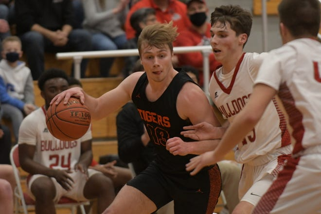 Kirksville senior forward Noah Copeland drives past a Mexico defender during the Class 5 District 15 title game in Mexico.