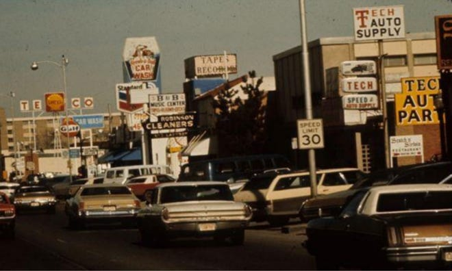 The view on University Avenue looking north from 19th Street before Lubbock adopted the sign ordinance in 1975.