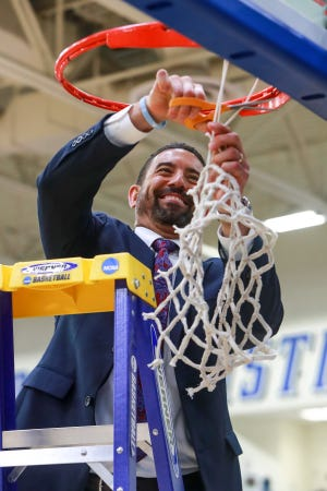 LCU coach Steve Gomez cuts down a net after the Lady Chaps won the Lone Star Conference tournament on March 6. LCU, national champions in 2016 and 2019, is the No. 1 seed in the Elite Eight of the Division II NCAA Tournament next week in Columbus, Ohio.