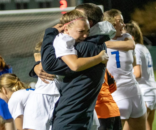 Lakeland Christian's Ramsey Watkins hugs head coach Jason Streets after the Vikings defeated Delray Beach American Heritage 4-2 on Wednesday to win the Class 3A girls soccer state title. Watkins provided the spark that turned the match in LCS's favor after she moved to midfield.