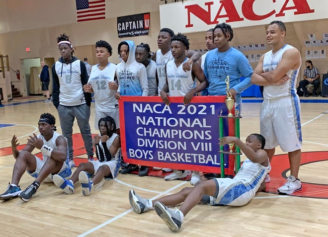 Jordan Christian players pose with the banner and trophy after winning the NACA 2021 National Championship.