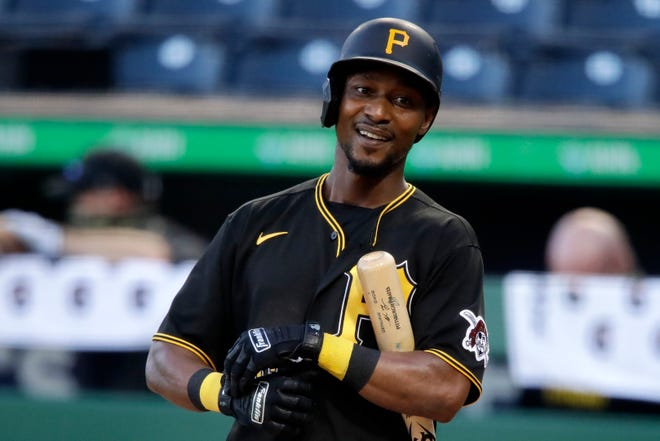 FILE - In this July 15, 2020, file photo, Pittsburgh Pirates' Jarrod Dyson smiles while batting during the team's intrasquad baseball game in Pittsburgh.