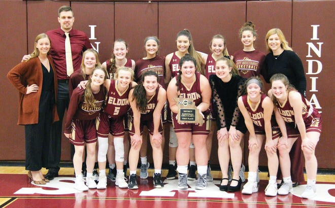The Eldon girls basketball team with its district championship plaque after topping rival Osage on Friday, March 5, in Osage Beach. It is the first district championship for the program in 31 years.