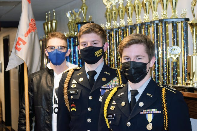 David Redding, Jacob Smith and Jonas Ross are among the seniors in the Junior ROTC program at Leavenworth High School who have received military college scholarships.