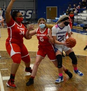 Gibraltar Carlson's Elyse Miller takes the ball inside against Mina Harris (15) and Akiyah Ash of Melvindale Friday night.