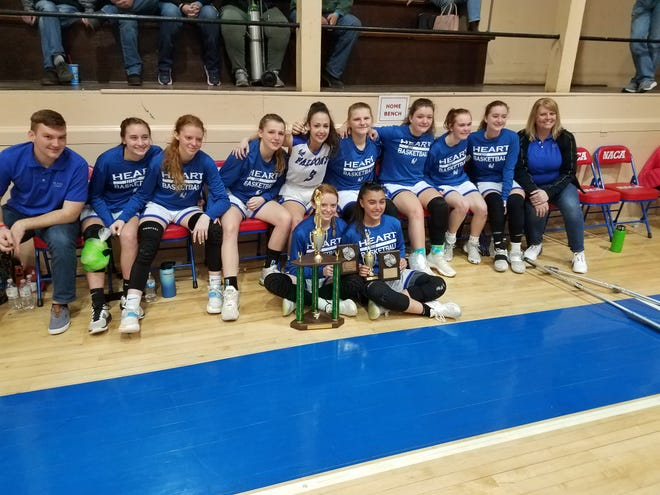 The HEART Falcons girls basketball team poses with their trophy after placed 2nd in the NACA Tournament in Dayton, Tenn.