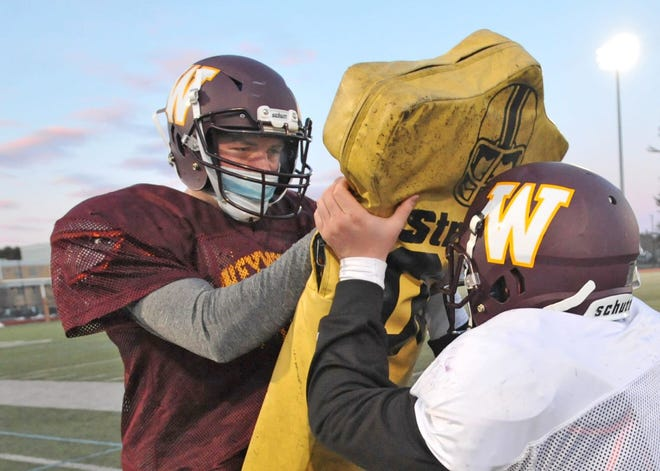 Weymouth's James Cassidy, left, and Conor Denizkurt drill during football practice, Friday, March 5, 2021.