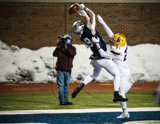 A potential game-winning touchdown pass goes off the hands of UNH's Nick Lorden late in the fourth quarter as the Wildcats dropped a 24-20 decision to Albany in the season opener Friday night at Wildcat Stadium.