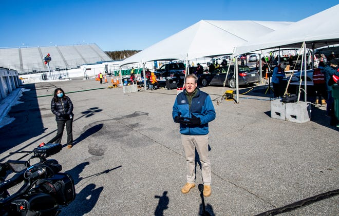 New Hampshire Gov. Chris Sununu holds a news conference outside of the COVID-19 vaccination tent at the New Hampshire Motor Speedway on Saturday, March 6, 2021.