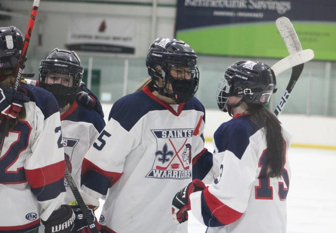 Memphis Brown (right) congratulates Sklyer Bednarek after her goal gave St. Thomas/Winnacunnet/Dover a 2-1 lead over Oyster River/Portsmouth in the first period of an NHIAA girls hockey playoff contest Friday, March 5, 2021 at Dover Ice Arena.