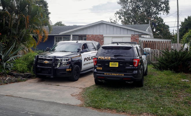 Boynton Beach Police cruisers were parked in the driveway of 66-year-old Roberto Colon on Southeast 28th Court on Saturday morning after human remains were found in Colon's backyard. DAMON HIGGINS / PALM BEACH POST