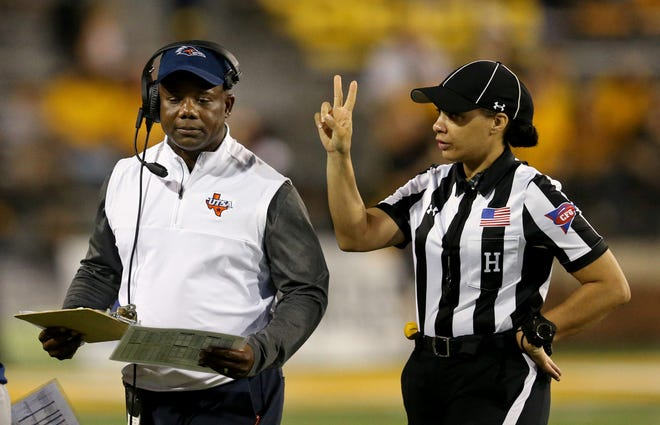 UTSA Roadrunners head coach Frank Wilson (left) talks to then head linesman Maia Chaka, now the first Black female referee in the history of the NFL.